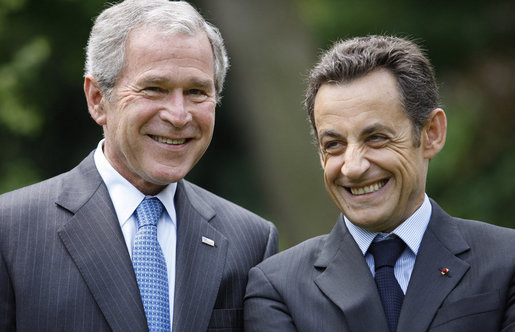 President George W. Bush and French President Nicolas Sarkozy spend a few moments together talking during a sculpture unveiling Saturday, June 14, 2008 at the U.S. Ambassador's residence in Paris. White House photo by Eric Draper