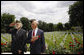 Two U.S. World War II veterans salute during the wreath-laying ceremony Saturday, June 14, 2008, at the Suresnes American Cemetery and Memorial in Suresnes, France. White House photo by Eric Draper