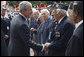 President George W. Bush stops to talk with U.S. veterans Saturday, June 14, 2008 in Paris. White House photo by Eric Draper