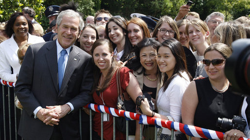 President George W. Bush poses for photos during his greeting with members of the U.S. Mission in France, Saturday, June 14, 2008, at the Ambassador's residence in Paris. White House photo by Eric Draper