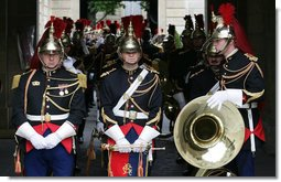 Band members await the arrival of President George W. Bush Saturday, June 14, 2008, as they stand near the courtyard of the Elysée Palace in Paris.  White House photo by Chris Greenberg