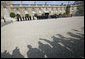 The media's shadow drops across the courtyard of the Elysée Palace in Paris Saturday, June 14, 2008, as the honor cordon and color guard prepare for the arrival of President George W. Bush, who spent the morning with France's President Nicolas Sarkozy. White House photo by Chris Greenberg