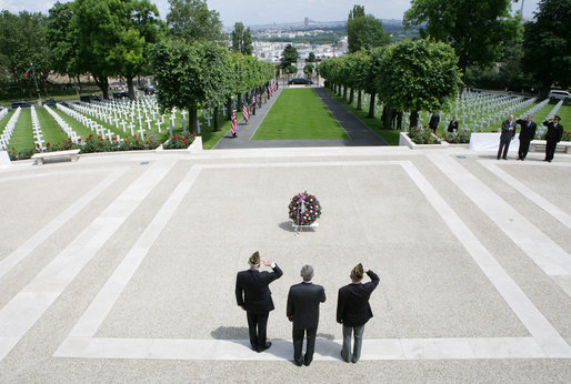 President George W. Bush is flanked by two U.S. World War II Veterans during wreath-laying ceremonies Saturday, June 14, 2008, at the Suresnes American Cemetery and Memorial in Paris. White House photo by Chris Greenberg