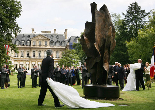 President George W. Bush and Laura Bush, accompanied by French President Nicolas Sarkozy, attend the unveiling of the Flamme de la Liberte sculpture Saturday, June 14, 2008, at the U.S. Ambassador's residence in Paris. White House photo by Shealah Craighead