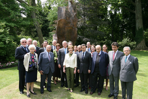 President George W. Bush, Laura Bush, and members of the U.S. delegation, join French President Nicolas Sarkozy and members of the French delegation, for a group photo following the unveiling of the Flamme de la Liberte sculpture Saturday, June 14, 2008, at the U.S. Ambassador's residence in Paris. White House photo by Shealah Craighead