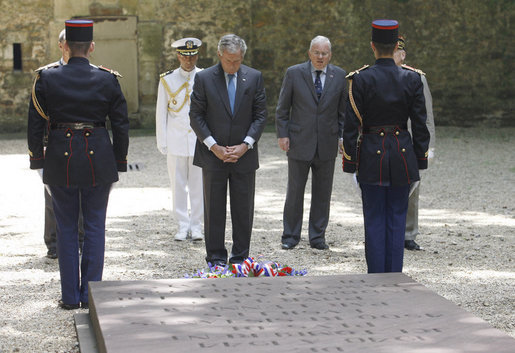 President George W. Bush pays his respects at the Mont Valerien memorial Saturday, June 14, 2008 in Suresnes, France, honoring members of the French Resistance executed by German soldiers during World War II. White House photo by Eric Draper
