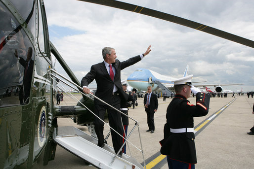 President George W. Bush waves on his arrival at London's Heathrow International Airport Sunday, June 15, 2008, boarding Marine One for a flight to Windsor Castle to meet Queen Elizabeth II. White House photo by Chris Greenberg