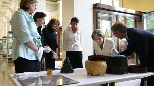 Mrs. Laura Bush is shown artifacts from the Afghani and Burmese Collections at the British Museum in London on Monday, June 16, 2008. White House photo by Shealah Craighead
