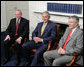President George W. Bush joins Northern Ireland First Minister Peter Robinson, right, and Deputy First Minister Martin McGuinness, left, during their meeting Monday, June 16. 2008, at Stormont Castle in Belfast, Northern Ireland. White House photo by Chris Greenberg
