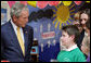 President George W. Bush speaks with a young student Monday. June 16, 2008, during his visit to the Lough Integrated Primary School in Belfast, Ireland. White House photo by Chris Greenberg