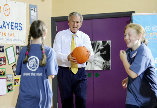 President George W. Bush participates in a basketball game Monday. June 16, 2008, during a visit to the Lough Integrated Primary School in Belfast, Ireland. White House photo by Shealah Craighead