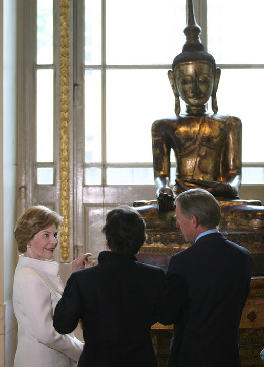 Mrs. Laura Bush is shown a statue during her tour of the Afghani and Burmese Collections at the British Museum in London on Monday, June 16, 2008. White House photo by Shealah Craighead