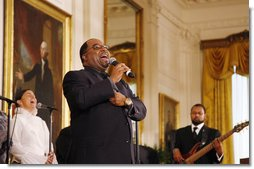 Kurt Carr and the Kurt Carr Singers perform for President George W. Bush and guests Tuesday, June 17, 2008 in the East Room of the White House, in honor of Black Music Month.  White House photo by Eric Draper