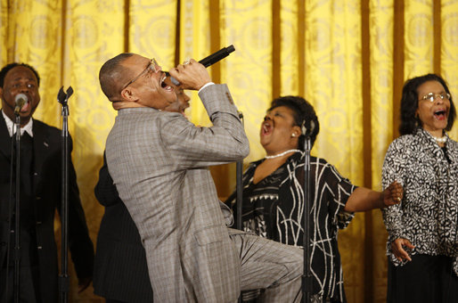 Singer Walter Hawkins performs on stage in the East Room of the White House, where he was joined on stage by his brother, Edwin, Tuesday, June 17, 2008, in honor of Black Music Month. White House photo by Eric Draper