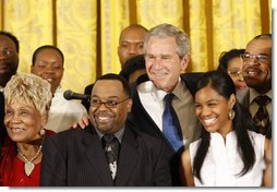 President George W. Bush joins singers Narcissus Brown, left, Kurt Carr, Spensha Baker and Walter Hawkins on stage in the East Room of the White House, follwing their performances Tuesday, June 17, 2008, in honor of Black Music Month.  White House photo by Eric Draper