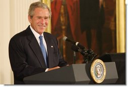 President George W. Bush welcomes guests and entertainers Tuesday, June 17, 2008 to the East Room of the White House, in honor of Black Music Month.  White House photo by Luke Sharrett