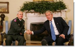 President George W. Bush thanks U.S. Army General Dan McNeill, former commander of the International Security Assistance Force, for his command service in Afghanistan following their meeting in the Oval Office Tuesday, June 17, 2008.  White House photo by Joyce N. Boghosian