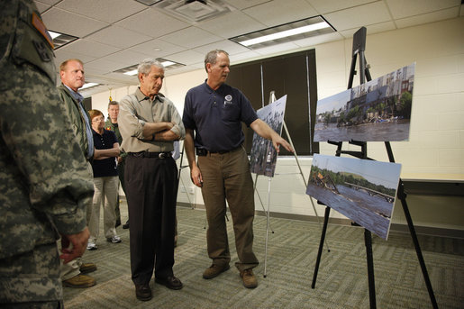President George W. Bush is briefed on the Midwest flooding by Dick Hainje, Regional Administrator for the Federal Emergency Management Agency, during a visit Thursday, June 19, 2008, to Cedar Rapids, Iowa. The President spent the day touring the devastation left in the wake of the flooding Cedar and Iowa rivers. White House photo by Eric Draper