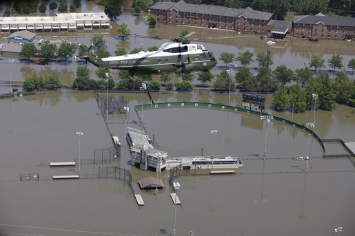 Marine One with President George W. Bush aboard flies over a flooded University of Iowa softball complex in Iowa City Thursday, June 19, 2008, during his aerial tour of the region. White House photo by Eric Draper