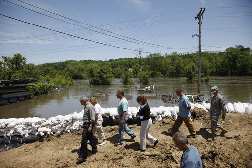 President George W. Bush tours Streb Construction Company in Iowa City, Iowa Thursday, June 19, 2008, as sandbags hold back the flooding Iowa River waters. White House photo by Eric Draper