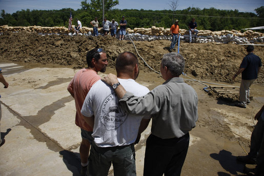 "President George W. Bush pauses to talk during his visit to the flood-ravaged Iowa City, Iowa area Thursday, June 19, 2008. The President told the governor of the state, ""I'm sorry we're going through this. Tell people that often times you get dealt a hand you didn't expect to have to play, and the question is not whether you're going to get dealt the hand; the question is how do you play it. And I'm confident the people of Iowa will play it really well."" White House photo by Eric Draper"
