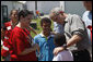 President George W. Bush comforts a family displaced by recent flooding during his visit Thursday, June 19, 2008, to a Red Cross shelter in Iowa City, Iowa. White House photo by Eric Draper