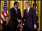 President George W. Bush shakes hands with Dr. Benjamin Carson Thursday, June 19, 2008, after presenting him with the 2008 Presidential Medal of Freedom during ceremonies in the East Room of the White House. White House photo by David Bohrer