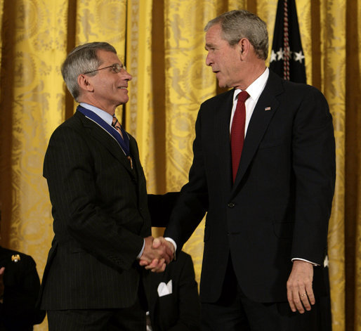 President George W. Bush shakes hands with Dr. Anthony Fauci Thursday, June 19, 2008, after presenting him with the 2008 Presidential Medal of Freedom during ceremonies in the East Room of the White House. White House photo by David Bohrer