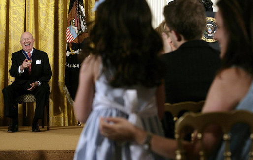 Laurence Silberman laughs as he acknowledges a standing ovation by a young girl in the audience Thursday, June 19, 2008, after he was presented the 2008 Presidential Medal of Freedom by President George W. Bush in the East Room of the White House. White House photo by David Bohrer