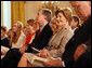 Mrs. Laura Bush smiles as she listens to the acknowledgments of the 2008 Presidential Medal of Freedom recipients during ceremonies Thursday, June 19, 2008, in the East Room of the White House. White House photo by Shealah Craighead