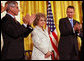 Mrs. Annette Lantos, wife of the late Mr. Tom Lantos, receives applause in honor her husband who was awarded the Presidential Medal of Freedom Thursday, June 19, 2008, in the East Room of the White House. White House photo by Shealah Craighead
