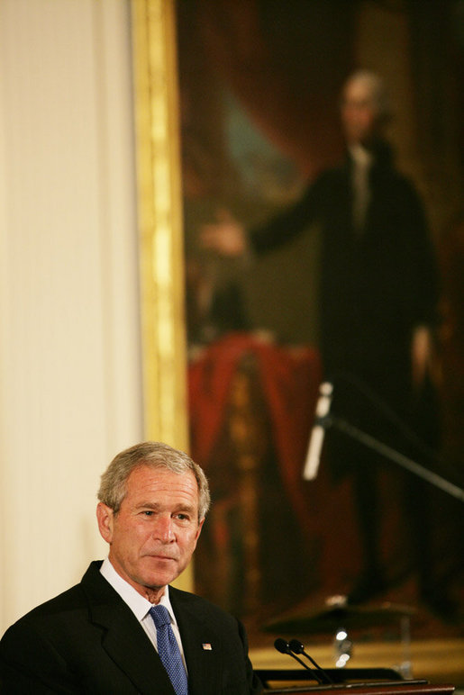 President George W. Bush welcomes guests Thursday evening, June 19, 2008 to the East Room of the White House, during a social dinner in honor of American jazz. White House photo by Chris Greenberg