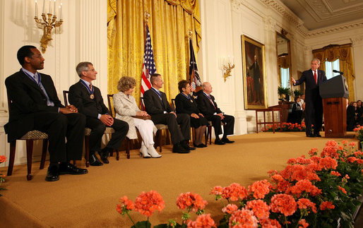 President George W. Bush welcomes the recipients of the Presidential Medal of Freedom during his remarks at the presentation of the Presidential Medal of Freedom ceremony Thursday, June 19, 2008, in the East Room of the White House. White House photo by Shealah Craighead