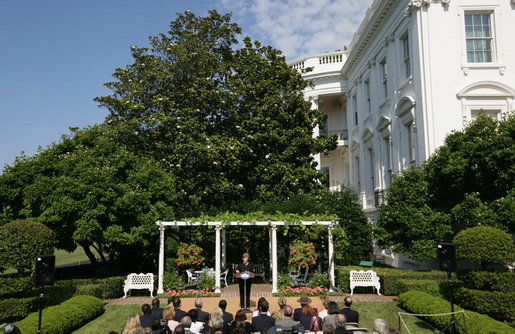 Mrs. Laura Bush delivers remarks in honor of World Refugee Day Friday, June 20, 2008, in the East Garden of the White House. In addressing her guests, Mrs. Bush announced the approval by President George W. Bush of a $32.8 million emergency funding to support unexpected and urgent needs, including food, for refugees and conflict victims in Africa, the Middle East, Asia and the Western Hemisphere. White House photo by Shealah Craighead