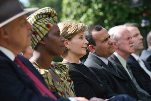 Mrs. Laura Bush listens to participants during a celebration of World Refugee Day Friday, June 20, 2008, in the East Garden of the White House. The event acknowledged the compassion of the American people in welcoming refugees into U.S. society and highlighting their contributions. White House photo by Shealah Craighead