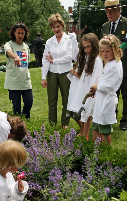 Mrs. Bush observes students of the Boys and Girls Club of Boston and Warren Prescott Elementary School who are planting gardens in the Charlestown Navy Yard Sunday, June 22, 2008 in Boston, MA, during a First Bloom event aimed at introducing children to plant species native to their area and educating kids about seed cultivation, garden design, and monitoring species. White House photo by Shealah Craighead