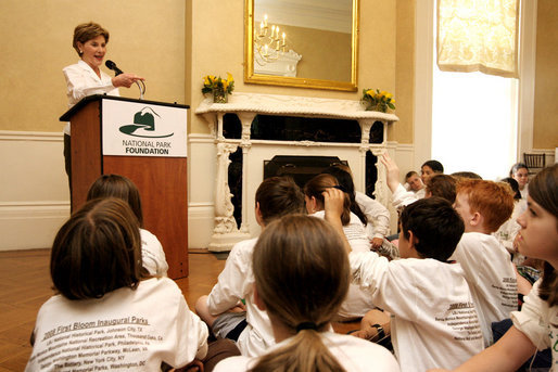 During remarks, Mrs. Bush calls on a student to name a type of plant they planted earlier in the day during National Park First Bloom event at the Charlestown Navy Yard in Boston, MA, Sunday, June 22, 2008. White House photo by Shealah Craighead