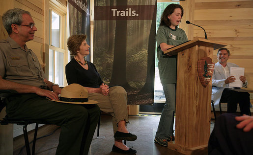 Mrs. Laura Bush listens to Rachel Allen, a student in the Service-Learning Program, as she delivers remarks during an Active Trails! event at Marsh-Billings-Rockefeller National Historical Park Monday, June 23, 2008, in Woodstock, Vt. Also shown are Rolf Diamant, Superintendent of Marsh-Billings-Rockefeller National Historical Park, and Vin Cipolla, President of the National Parks Foundation. Mr. Cipolla just announced a $50, 000 grant from the National Park Foundation to the Marsh-Billings-Rockefeller National Historical Park to connect the Forest Center to the Woodstock Trails Network. White House photo by Shealah Craighead