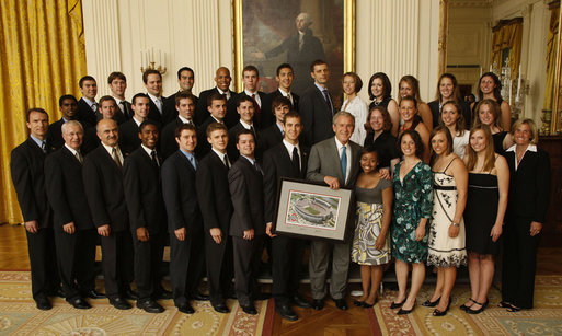 President George W. Bush stands with members of the Ohio State University Men's and Women's Fencing Team at the White House on Tuesday, June 24, 2008, during the visit of the 2007 and 2008 NCAA Sports Champions. White House photo by Eric Draper