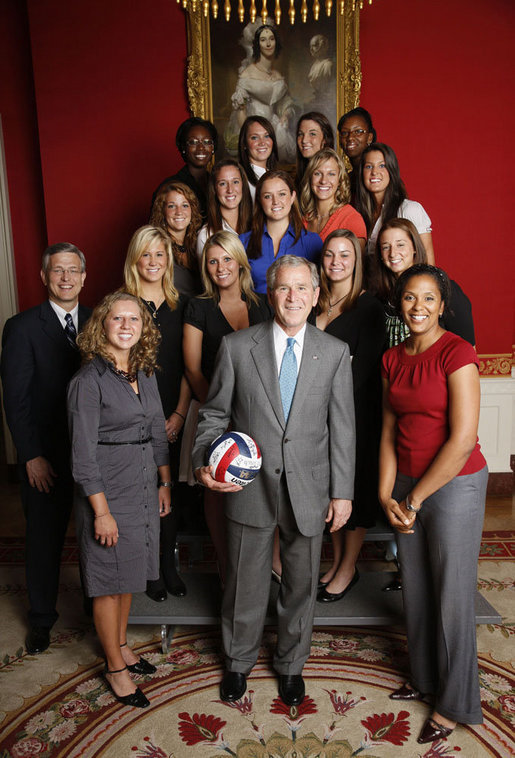 President George W. Bush poses with members of the Pennsylvania State University Women's Volleyball Team in the Red Room of the White House during the June 24, 2008, visit of the 2007 and 2008 NCAA Sports Champions. White House photo by Eric Draper