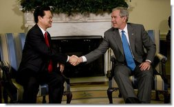 President George W. Bush exchanges handshakes with Prime Minister Nguyen Tan Dzung of the Socialist Republic of Vietnam, during their meeting Tuesday, June 24, 2008, in the Oval Office of the White House. White House photo by Eric Draper
