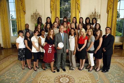 President George W. Bush stands with members of the University of Southern California Women's Soccer team, Tuesday, June 24, 2008, during a photo opportunity with the 2007 and 2008 NCAA Sports Champions. White House photo by Eric Draper