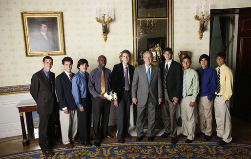 President George W. Bush stands with members of the University of Oregon Men's Cross Country, Tuesday, June 24, 2008, during a photo opportunity with the 2007 and 2008 NCAA Sports Champions. White House photo by Eric Draper