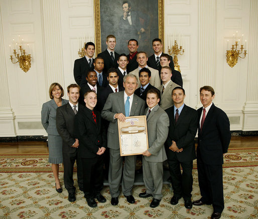 President George W. Bush stands with members of the University of Oklahoma Men's Gymnastics' team, Tuesday, June 24, 2008, during a photo opportunity with the 2007 and 2008 NCAA Sports Champions. White House photo by Eric Draper