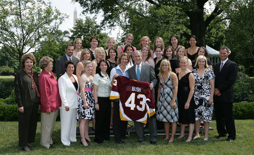 President George W. Bush stands with members of the University of Minnesota-Duluth Women's Ice Hockey team, Tuesday, June 24, 2008, during a photo opportunity with the 2007 and 2008 NCAA Sports Champions at the White House. White House photo by Chris Greenberg