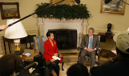 "President George W. Bush welcomes President Gloria Macapagal-Arroyo of the Republic of the Philippines to the Oval Office Tuesday, June 24, 2008, at the White House. The President expressed deep condolences for those affected by Typhoon Fengshen saying, ""We, the American people, care about the human suffering that's taking place, and we send our prayers."" White House photo by Eric Draper"