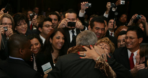 President George W. Bush is greeted enthusiastically by his audience after delivering remarks Thursday, June 26, 2008 to the National Hispanic Prayer Breakfast in Washington, D.C. The breakfast was hosted by Esperanza, one of the leading voices and faith-based organizations for Hispanic Americans. White House photo by Chris Greenberg