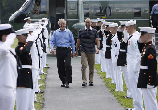 President George W. Bush walks with Crown Prince Sheikh Mohammed bin Zayed Al Nahyan of Abu Dhabi, UAE, through an honor guard upon his arrival to Camp David, Thursday, June 26, 2008 in Camp David, Md. White House photo by Eric Draper