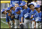 Players of the Jose M. Rodriguez Little League Angels of Manati, Puerto Rico, all look over toward President George W. Bush as he welcomes everyone to the 2008 Tee Ball on the South Lawn Season Opener Monday, June 30, 2008, on the South Lawn of the White House. White House photo by Eric Draper