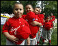 Players of the Cramer Hill Little League Red Sox of Camden, New Jersey hold their hats over their hearts during the singing of the National Anthem at the 2008 Tee Ball on the South Lawn Season Opener Monday, June 30, 2008, on the South Lawn of the White House. White House photo by Eric Draper